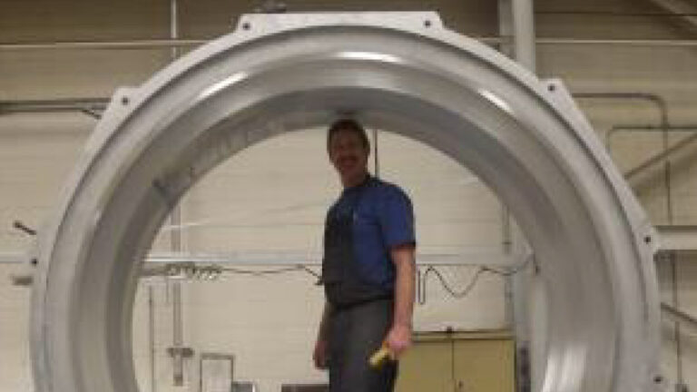 Paragon employee standing inside mold