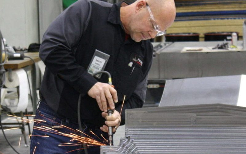Paragon D&E employee working on resin transfer molding project