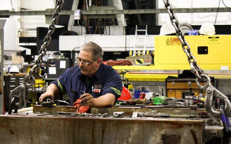 Paragon D&E machinist working on a machine tool repair