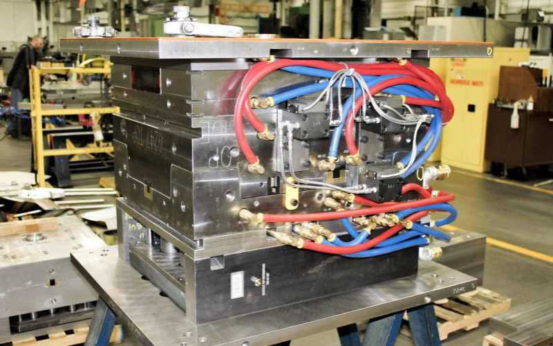 A Paragon D&E plastic injection molding machine